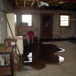 A flooded basement showing groundwater intrusion in Islip
